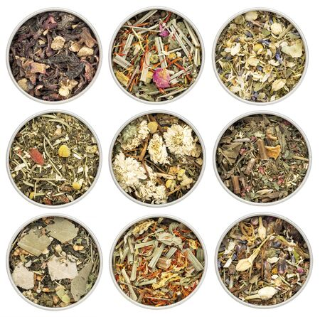 blend: collection of nine herbal blend Chinese tea in round metal cans, top view isolated on white Stock Photo