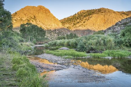North Fork of Cache la Poudre River in Eagle Nest Open Space in northern Colorado at Livermore near Fort Collins, late summer sunset