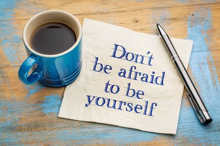 be yourself: Dont be afraid to be yourself - handwriting on a napkin with a cup of espresso coffee