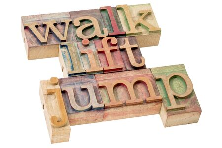 exercise and fitness  concept - walk, jump, and lift  - isolated word abstract in letterpress wood type Stock Photo