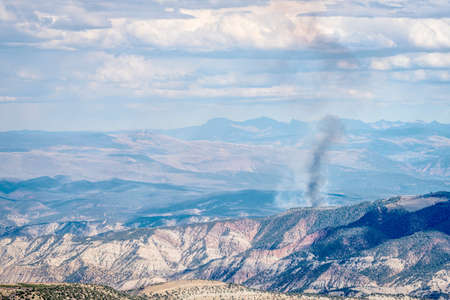 controlled: smoke plume from controlled forest burn in White RIver National Forest, Rocky Mountains, Colorado