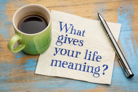 meaning: What gives your life meaning - a philosophical question on a napkin with a cup of coffee