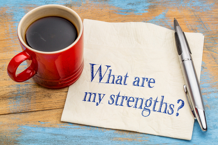 what are my strengths question - handwriting on a napkin with a cup of coffee