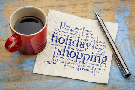 holiday shopping word cloud - handwriting on a napkin with a cup of coffee Stock Photo