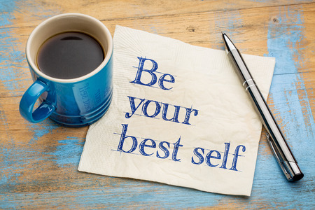 Be your best self - handwriting on a napkin with a cup of espresso coffee