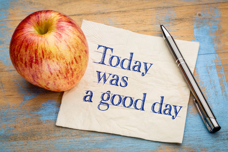 affirmation: Today was a good day positive affirmation - handwriting on a napkin with a fresh apple Stock Photo