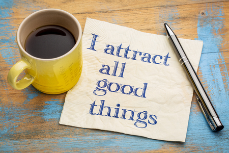I attract all good things - positive affirmation  words - handwriting on a napkin with a cup of coffee Stock Photo