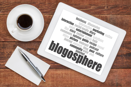 blogosphere: blogosphere word cloud on a digital tablet with a cup of coffee and note pad - blogging concept Stock Photo