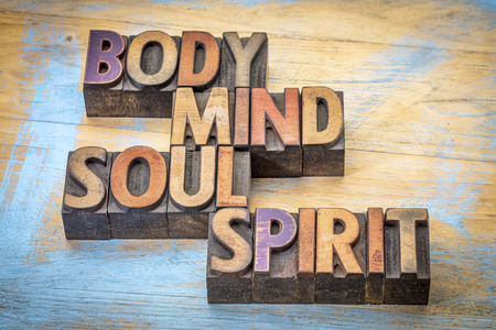mind body spirit: body, mind, soul and spirit word abstract -text in vintage letterpress  wood type printing blocks against grunge wood