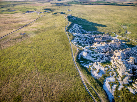 castle rock: prairie ranch roads and limestone outcroppings near Castle Rock  in Kansas (Gove County), aerial view