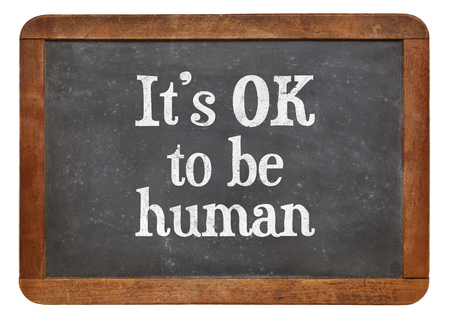 alright: It is OK to be human - white chalk text on a vintage slate blackboard