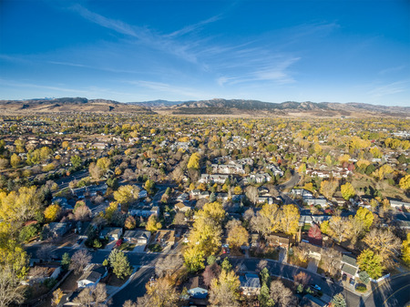 aerial view of Fort Collins in northern Colorado with foothills and Rocky Mountains in background
