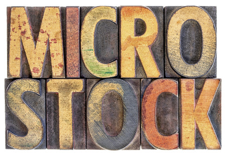 microstock: microstock photography concept - isolated word abstract in vintage letterpress wood block type, stained by color ink