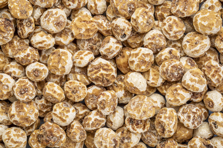 organic peeled tiger nuts, a rich source of resistant starch, top view background Reklamní fotografie