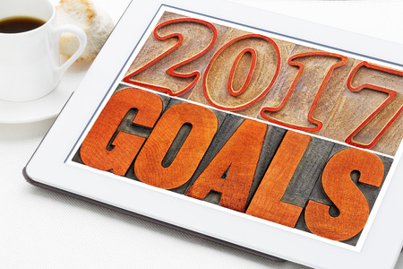 2017 goals banner - New Year resolution concept - text in vintage letterpress wood type printing blocks on a digital tablet with a cup of coffee