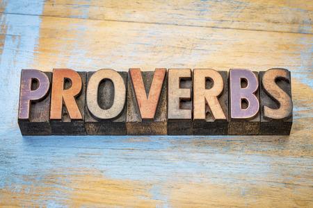 proverbs - word abstract in vintage letterpress wood type printing blocks against grunge wood