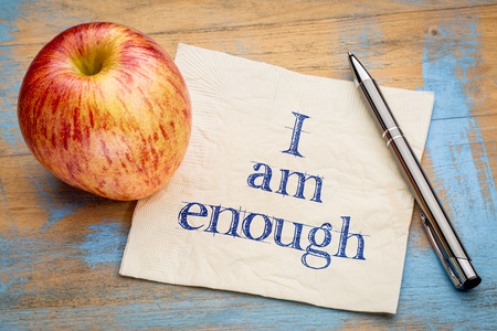 affirmation: I am enough positive affirmation - handwriting on a napkin with a fresh apple Stock Photo