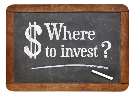 where: Where to invest question  - white chalk text on a vintage slate blackboard