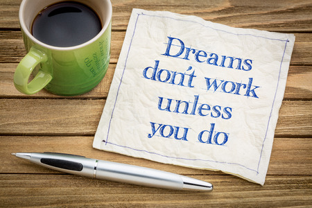 Dreams do not work unless you do - handwriting on a napkin with a cup of espresso coffee