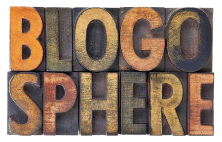 blogosphere: blogosphere (global blog community) word abstract in vintage wood letterpress types, stained by ink, isolated on white