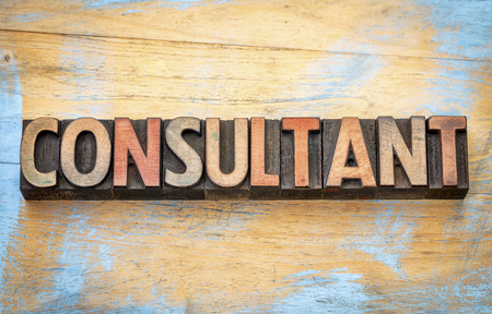 consultant  - word abstract in vintage letterpress wood type printing blocks