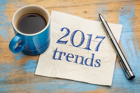 estimation: 2017 trends concept - handwriting on a napkin with a cup of espresso coffee