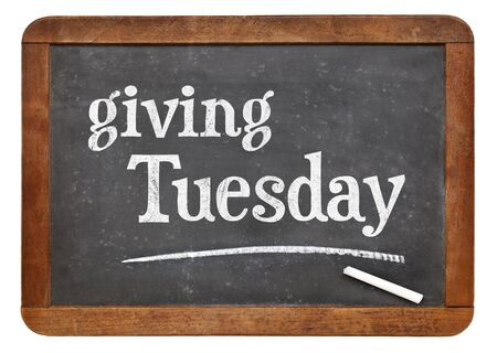 commercialization: Giving Tuesday  -white chalk text on a slate blackboard Stock Photo