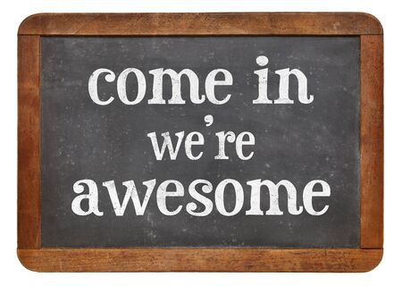 come in: Come in. We are awesome. Invitation sign - white chalk text on a vintage slate blackboard
