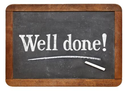 compliment: Well done sign - white chalk text on a vintage slate blackboard Stock Photo
