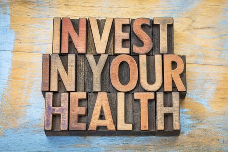 letterpress blocks: invest in your health - word abstract in vintage letterpress wood type printing blocks Stock Photo