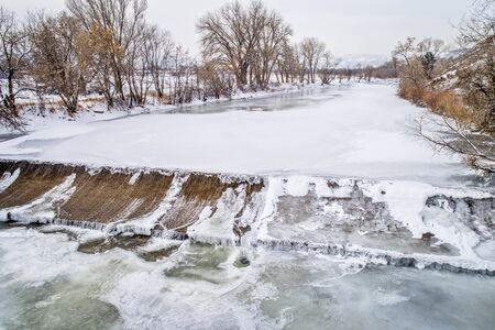 one of numerous water diversion  dams on the Poudre River - aerial view of winter scenery Stock Photo