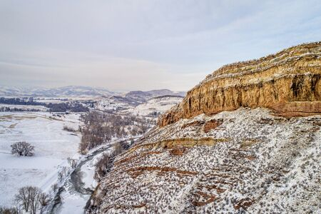 sandstone cliff of Belvue Dome and Cache la Poudre River above Fort Collins in northern Colorado, aerial view of winter scenery