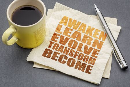awaken: awaken, learn, evolve, transform and become - inspirational word abstract on a napkin with a cup of tea