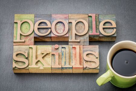 interpersonal: people skills word abstract in letterpress wood type with a cup of coffee