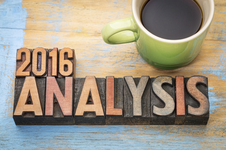 2016 analysis word abstract in letterpress wood type with a cup of coffee