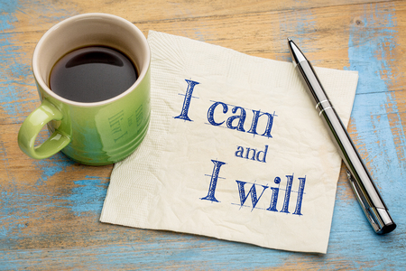 I can and I will motivational concept - handwriting on a napkin with a cup of coffee