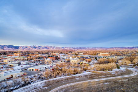 aerial view of Fort Collins downtown, Poudre River and a bike trail, cold morning winter scenery