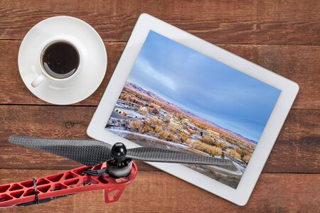 poudre river: aerial view of Fort Collins downtown, Poudre River and a bike trail on digital tablet with coffee and drone propeller, screen image copyright by the photographer Stock Photo