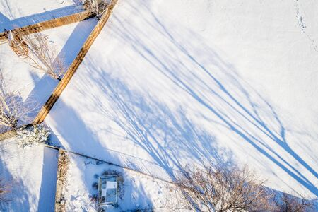 footmark: backyards and fences in winter - aerial view with long shadows Stock Photo