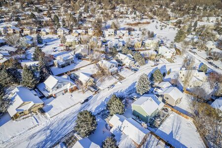 residential neighborhood: aerial  view of typical residential neighborhood along Front Range of Rocky Mountains in Colorado, winter scenery