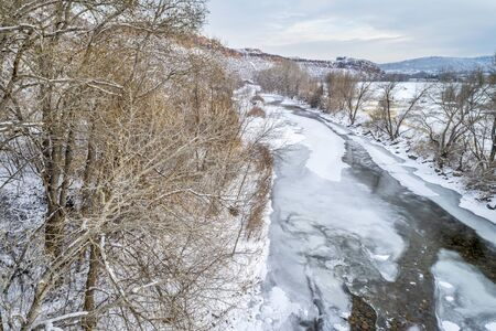 collins: partially frozen Poudre River at Belvue Dome above Fort Collins, Colorado - aerial view of winter scenery Stock Photo