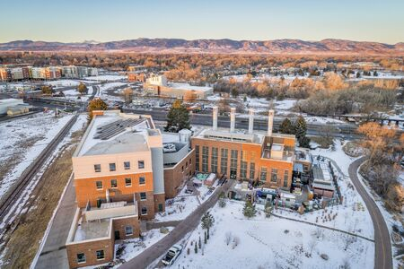 FORT COLLINS, CO, USA - DECEMBER 24, 2016: Powerhouse Energy Campus of Colorado State University - a new building completed in 2014 and historic Municipal Power Plant, aerial view at winter sunrise.