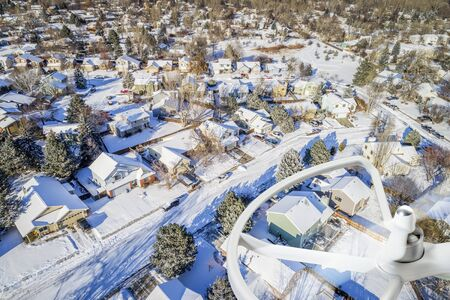 residential neighborhood: aerial  view of typical residential neighborhood along Front Range of Rocky Mountains in Colorado, winter scenery with a drone propeller Stock Photo