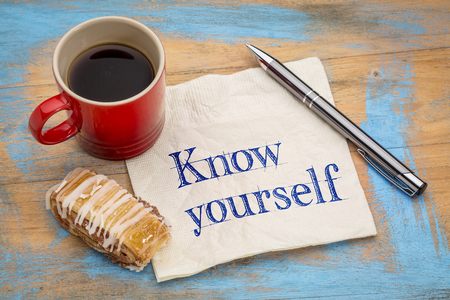 self discovery: Know yourself concept - handwriting on a napkin with a cup of espresso coffee and pastry