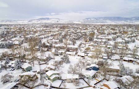 colorado rocky mountains: aerial  view of typical residential neighborhood along Front Range of Rocky Mountains in Colorado, winter scenery with fresh snow Stock Photo