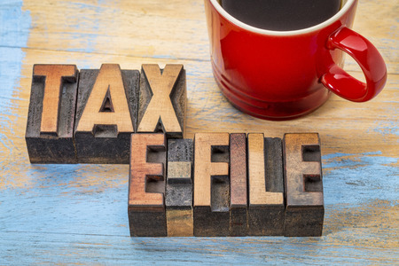 tax electronic filing concept - word abstract in vintage letterpress wood type with a cup of coffee
