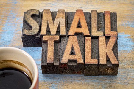 Small talk word abstract in vintage letterpress wood type with coffee