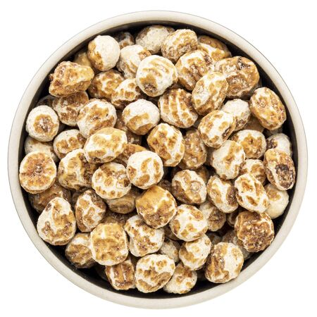 organic peeled tiger nuts, a rich source of resistant starch, in an isolated round bowl