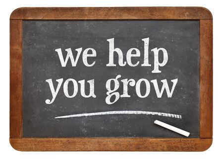 couching: we help you grow blackboard sign - white chalk text on a vintage slate chalk board Stock Photo