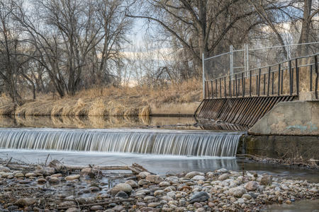 water diversion dam on the Poudre River at Legacy Park in Fort Collins, winter scenery